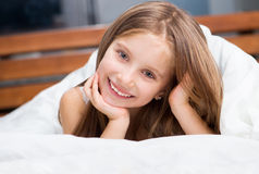 Beautiful little girl under a blanket Royalty Free Stock Photos