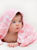 Beautiful little girl under towel Stock Images