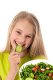 Beautiful little girl with vegetables Stock Photos