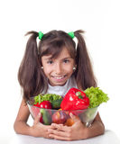 Beautiful little girl with vegetables Royalty Free Stock Photography