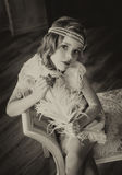 Beautiful little girl in vintage style royalty free stock photography