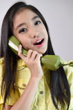 The beautiful little girl in vintage style talking on phone Stock Images