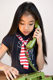 The beautiful little girl in vintage style talking on phone Royalty Free Stock Photos