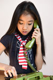 The beautiful little girl in vintage style talking on phone Stock Photography