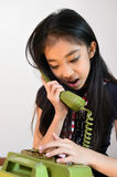 The beautiful little girl in vintage style talking on phone Stock Photos