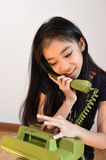 The beautiful little girl in vintage style talking on phone Royalty Free Stock Image