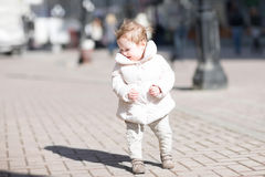 Beautiful little girl walking in the sun Stock Photos