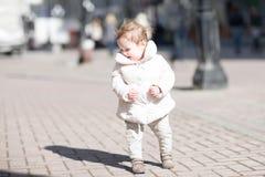 Beautiful little girl walking in the sun Stock Photos