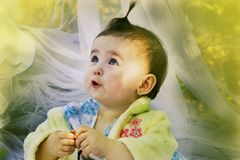 Beautiful little girl watching with admiration Stock Image