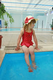 Beautiful little girl in the water pool Royalty Free Stock Photography