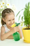 Beautiful little girl with water spray Stock Images