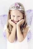 Beautiful little girl wearing diadem and butterfly wings Stock Images