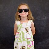 Beautiful little girl wearing sunglasses Royalty Free Stock Photography