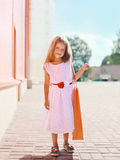 Beautiful little girl in white dress with shopping bag Royalty Free Stock Images