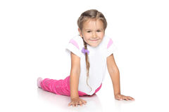 Beautiful Little Girl on white floor Royalty Free Stock Images