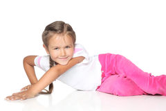 Beautiful Little Girl on white floor Royalty Free Stock Image
