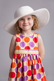 Beautiful little girl in a wide-brimmed hat Stock Images