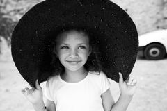 Beautiful little girl in a wide hat Royalty Free Stock Photography