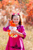 Beautiful little girl with a wonderful smile and happy on a summ Royalty Free Stock Image