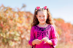 Beautiful little girl with a wonderful smile and happy on a summ Royalty Free Stock Photos