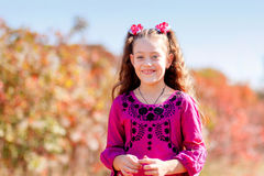 Beautiful little girl with a wonderful smile and happy on a summ Stock Photos