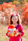 Beautiful little girl with a wonderful smile and happy on a summ. Er day. Happy child playing to have fun Royalty Free Stock Images