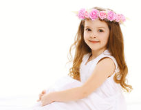 beautiful little girl with a wreath of flowers on he Royalty Free Stock Images