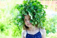 Beautiful little girl with a wreath of green leaves Royalty Free Stock Photo