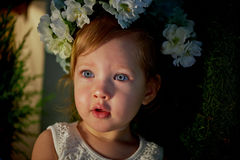 Beautiful little girl in a wreath on the head in green and white. Party dress,  Princess. Royalty Free Stock Photos