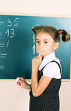 Beautiful little girl writing Stock Images