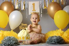 Beautiful little girl in yellow dress with sweet cake royalty free stock image