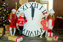 Beautiful little girls with a big clock Stock Image