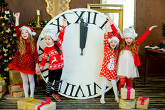 Beautiful little girls with a big clock Stock Photo