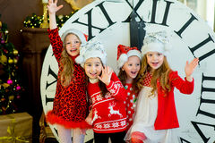 Beautiful little girls with a big clock Royalty Free Stock Photography
