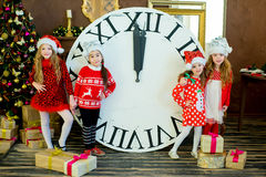 Beautiful little girls with a big clock Royalty Free Stock Photos