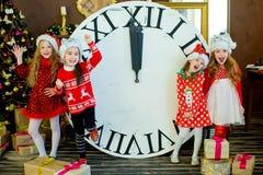 Beautiful little girls with a big clock Stock Photo