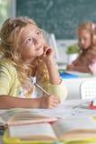 Beautiful little girls at class stock photography