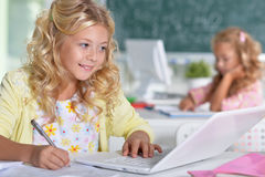Beautiful little girls at class Royalty Free Stock Photography
