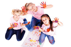 Beautiful little girls painting with their hands Stock Photos