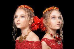 Beautiful  little girls in red dresses Stock Photos