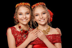 Beautiful  little girls in red dresses Royalty Free Stock Photo