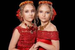 Beautiful  little girls in red dresses Stock Photography