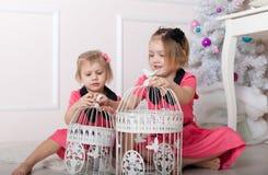 Beautiful little girls sitting on   floor Royalty Free Stock Photos