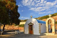 Beautiful little Greek chapel at sunset on the island of Crete - Greece. Beautiful little Greek chapel at sunset on the island of Crete - Greece Stock Image