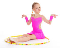 Beautiful little gymnast with the hoop Royalty Free Stock Photo