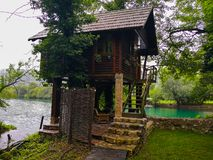 A beautiful little house next to the lake royalty free stock images
