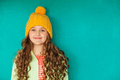 Beautiful little lady in yellow woolen cap Royalty Free Stock Images