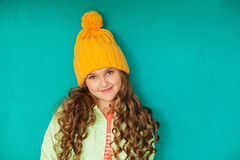 Beautiful little lady in yellow woolen cap Stock Photo