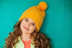 Beautiful little lady in yellow woolen cap Stock Image