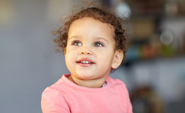 Beautiful little mulatto baby girl face. Childhood and people concept - beautiful little mulatto baby girl face Stock Photo